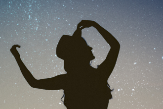 performer in front of a starry night background